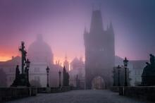 Charles Bridge In Prague At Foggy Morning In Czech Republic.