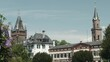 A warm summer afternoon in Weinheim, Germany with ancient buildings next to lush greenery