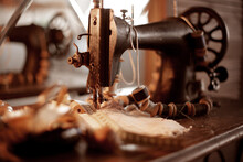 Retro Sewing Machine Close Up. A Set Of Sewing Threads. Selective Focus