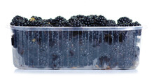 Plastic Container With Blackberries On White Background Isolation