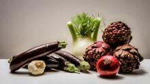 Close-up Of Eggplants, Fennel, Onion, Garlic, Artichokes On Table