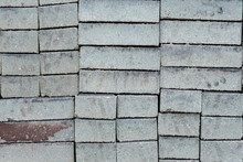 Rectangular Brick Shaped Concrete Pavers For Sale. On Display Outside A Garden Supply Store Or Hardware Shop.