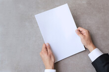 Male Hands Holding Blank White Paper