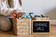 A Woman Prepared A Box Of Things For A Garage Sale. Decluttering, Cleaning And Moderate Consumption For A Sustainable Life