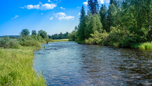Taiga River Nature Of The Russian North. Flyfisherman Using Flyfishing Rod In A River.