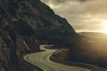 Winding Road Through Rocky Norwegian Landscape