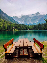 Bench On The Shore Of A Mountain Lake With A Beautiful Landscape.