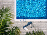 Fototapeta Perspektywa 3d - Swimming pool with wooden deck and chaise lounge