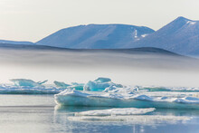 Icebergs And Rugged Mountains, Baffin Island, Canada.