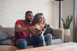Leinwandbild Motiv Young couple palying video games together at home.