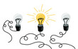 Hand-drawn row of light bulbs isolated on white background. Concept of idea. Vector illustration in doodle style