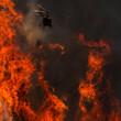 Leinwandbild Motiv Firefighter helicopter fighting hell in a forest fire.