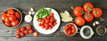 Concept Of Pickled Vegetables With Tomatoes On Rustic Wooden Table