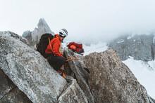 Climber Securing His Partner On Thin Ridgeline Near Mont Blanc