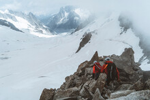 Roped Party On Rocky Ridge Above Glacier With Sun Rays