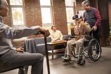 Elderly Men Gather In VR Glasses Together