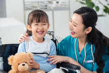 Doctor Examining Little Girl With Happyness