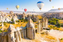 Hot Air Balloons Flying Over Love Valley Near Goreme Village. Cappadocia. Turkey