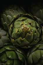 Raw Vegetables Artichokes . Closeup Selective Phocus. Dark Toning.