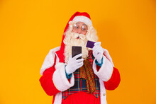 Santa Claus Using Credit Card To Pay For Internet Purchases