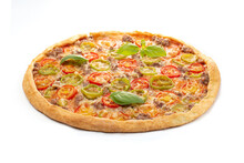 Italian Meat Pizza With Tomatoes, Three Types Of Meat (sausages, Bacon, Minced Meat), Mozzarella Cheese Decorated With Green Basil Leaves.