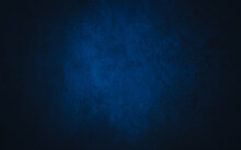 Dark Blue Textured Concrete Background With Center Light Spot . Abstract Texture For Graphic Design Or Wallpaper