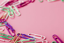 Multicolored Rzhivtkzhtsrbt Paper Clips Scattered On A Pink Background