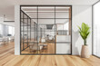 White open space with a conference room behind glass partition walls