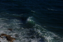 Ocean Wave Background Breaking Sea Water Rocky Shore Rough Seas Turquoise Water Gradient Foam. Big Waves At Open Sea. Summer Monsoon. White Crest Of A Sea Wave.