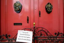 Covid19 Warning On An Old Door In Imdina Malta.