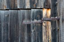 Background Of Bard Wood Slats And Rusty Hinge