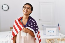 Young Hispanic Woman With Short Hair At Political Campaign Election Holding Usa Flag Looking Positive And Happy Standing And Smiling With A Confident Smile Showing Teeth