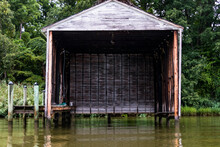An Empty Wooden Boathouse On The Patuxent River.