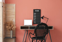 Comfortable Workplace Near Color Wall In Room