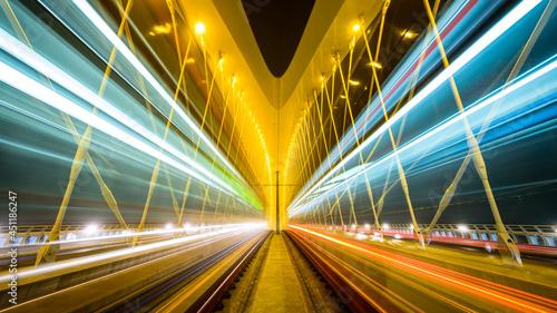 Moving trams on the Troja bridge (Trojsky most) in the misty evening in Prague, Czech republic.
