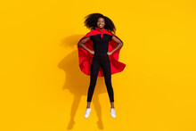 Full Length Body Size Photo Curly Girl Jumping High Wearing Red Cover Super Woman Isolated On Bright Yellow Color Background