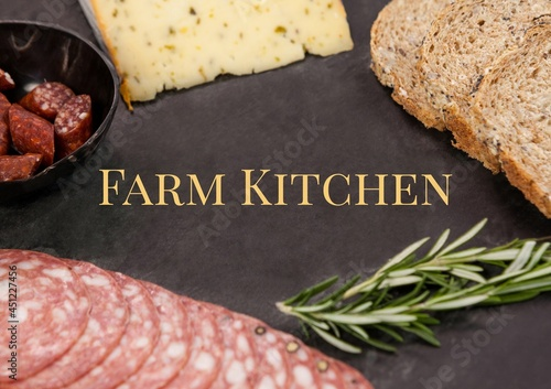 Composition of farm kitchen text over food on black table