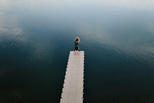 Man Standing In Pier Near Lake