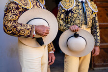 Crop Bullfighters In Golden Traditional Costume And Hats