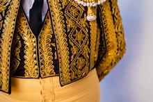 Crop Bullfighter In Golden Traditional Costume