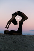 Couple Doing Acro Yoga In Evening In Highlands