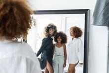 African American Females Looking At Mirror