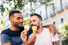 Multiethnic Homosexual Couple Eating Ice Cream