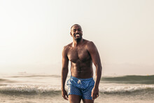 Cheerful Fit African American Man With Naked Torso At Seaside