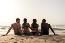 Anonymous Happy Diverse Friends On Wet Beach In Summer