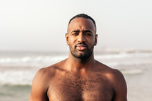 Fit African American Man With Naked Torso At Seaside