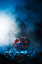 Close-up Of A Pumpkin On A Dark Background Prepared To Celebrate Halloween