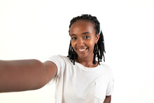 Self Photo Of A Woman Smiling Looking At Camera. Selfie Picture. White Background. African-Ethiopian Black Woman.