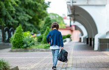 A Beautiful Little Girl, A Schoolgirl, In The Afternoon Near The School, In A School Uniform