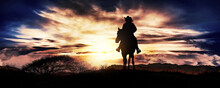 Cowgirl On A Horse At Sunset